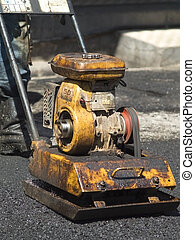 Old, little compactor plate - Old, worn, little compactor...