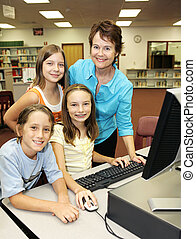 Teacher With Students - A helpful teacher instructing her...