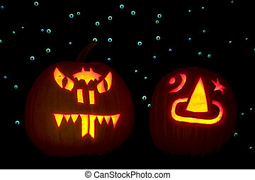 Two Carved Pumpkins - Two carved pumpkins, lighted with...