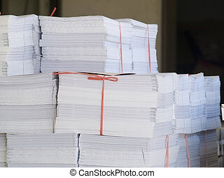 Piles of printed paper - Piles of printed, folded but uncut...