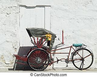 Trishaw parked at a white wall - Red, Asian trishaw parked...