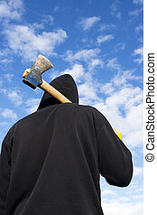 axe - man with an axe on sky background