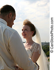 Newly married pair - The bride looks in the face to the...