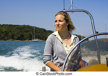 Cruising The Med - A beautiful young woman driving her...