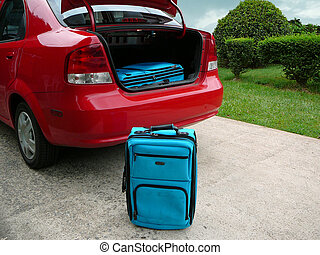 Car Trip - Suitcases beside car an in trunk