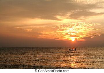 Sunrise fishing boat - Golden sunrise of the coast of...