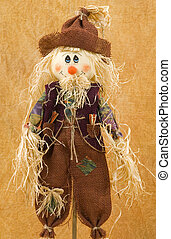 Scarecrow on seasonal background