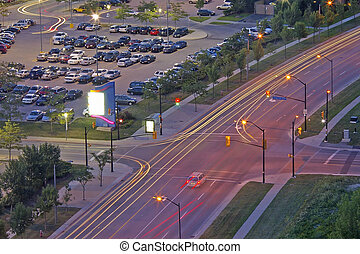 Intersection at Dusk - Overhead long-exposure view of...