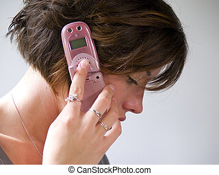 Pink Cell Phone - A portrait of an attractive young adult...