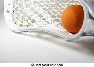 Lacrosse Head - a white lacrosse stick head and an orange...