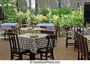 Italian restaurant - Outdoor italian restaurant with chairs...