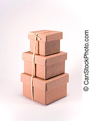 Boxes - three cardboard gift boxes with a ribbon on a...