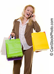 Excited shopper on the phone - Attractive blond woman...