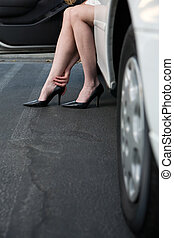 Sore feet - Womans sitting in car with legs out wearing sexy...