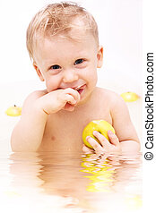 little boy - cute little boy in the bath eating apple