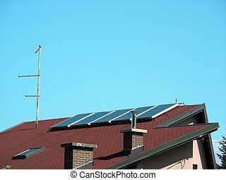 solar house - Modern house with solar energy cell on the...
