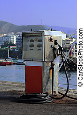 Gas station - An old and battered pump and hose from a old...