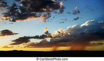 Rain on the Horizon - Rain clouds and a storm in the...
