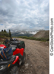 ATV Trail - All-terrain-vehicle parked beside mountain trail...