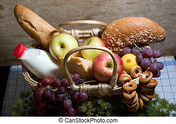basket with food - apples, cheese, milk, vinegar etc With...