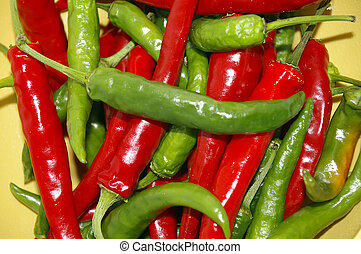 Red & Green Chili Peppers - Closeup of a pile of ripe red...