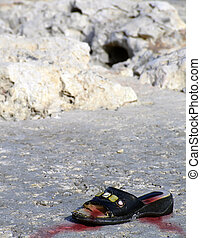 Warzone - Lone battered shoe belonging to a warzone victim