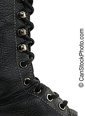 Closeup of black leather boot, showing laces in detail.