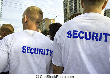 security - focus point on back of the nearest man right side...