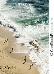 Beach birds eye view - Bathers contemplating the heavy sea,...