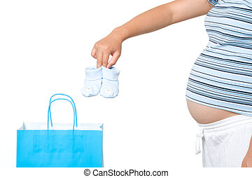 Shopping pregnant woman - A pregnant woman taking out baby...