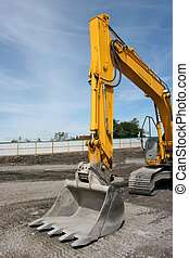 Excavator Bucket - Steel excavator bucket on a yellow...