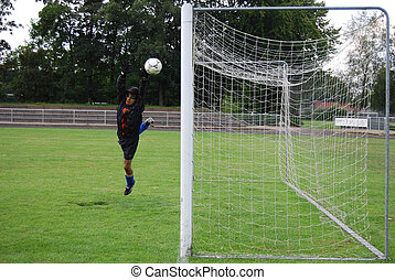 Goal keeper in action - Goal keeper in full lenght to save...