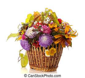 autumn basket with flowers and leaves isolated on white