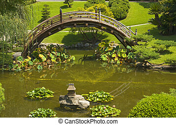 bridge in Japanese garden - wooden bridge in Japanese garden