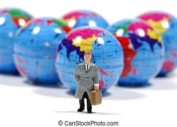 Business Travel - Photo of Minature Globes and a Miniature...