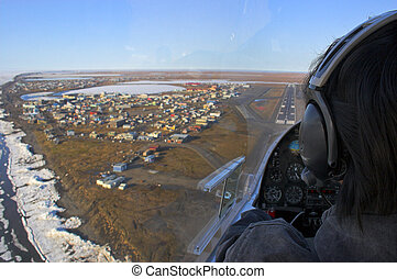 Landing into arctic village - Pilot of a small airplane...