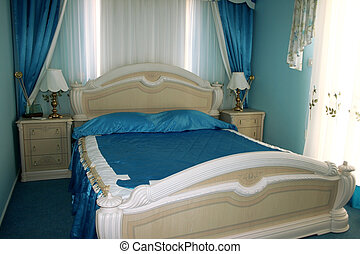 Bedroom - Nice blue bedroom with many  luxurious details.