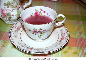 Tea cup with pink tea - Floral Tea cup and saucer with Pink...