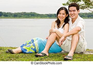 Couple Outdoors - A young Asian couple spending time...