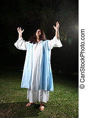 Praise and Exaltation - Biblical man wearing white robe and...