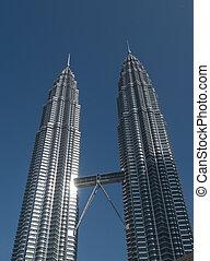 Petronas Twin Towers in Kuala Lumpur, Malaysia with...