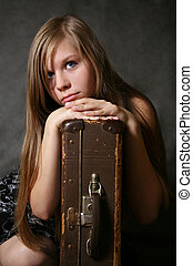 Young girl - Portrait of the young girl with a suitcase