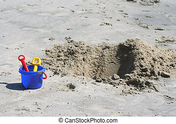 Shovel, pail and sand pit - A Shovel, pail and sand pit on...