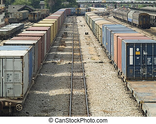 Trains at the station - Freight and passenger trains at a...