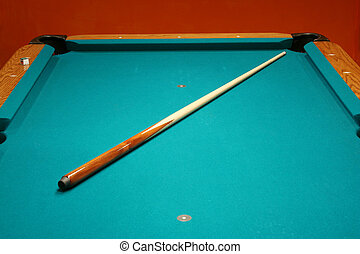 Cue stick on a pool table - Cue stick on a green pool table