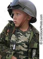 Military boy - Boy in a soldier\\\'s uniform with serious...