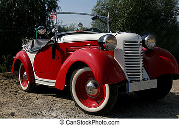 Old american car - Old red and white american bantam at the...