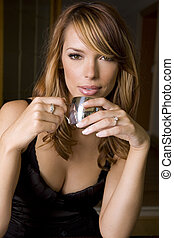 coffee break - stunning woman holding cup of espresso...