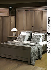 evening bedroom - interior of modern bedroom by evening