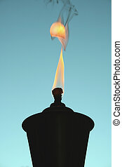 Tiki Torch silhouette - a Tiki Torch silhouette with flame